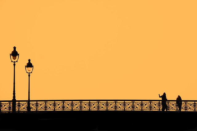 Golden hour at Paris's Notre Dame bridge