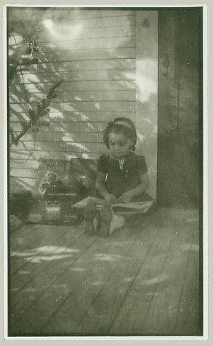 Child reading on porch
