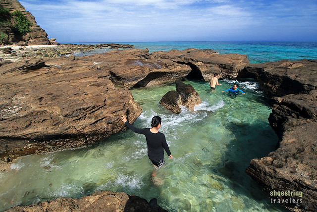 rock-enclosed natural pool at Animasola Island