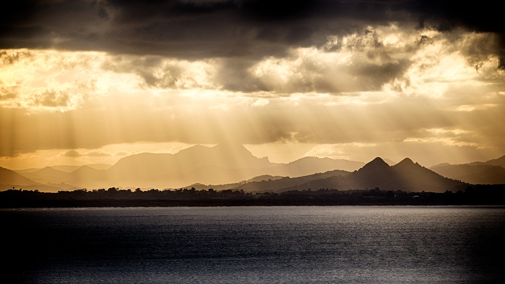 Sunbeams Over Volcanic Mountains A Spectacular Sunset