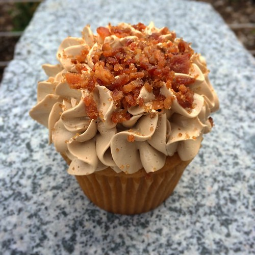 "Today's cupcake voted Seattle's number one ""pancake""! Pancake & candied bacon. 
