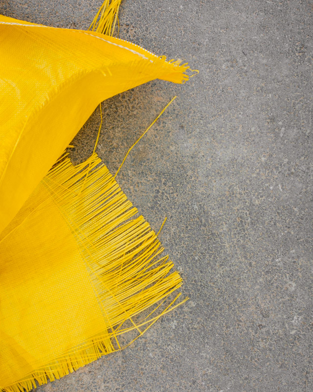 yellow frayed tarpaulin