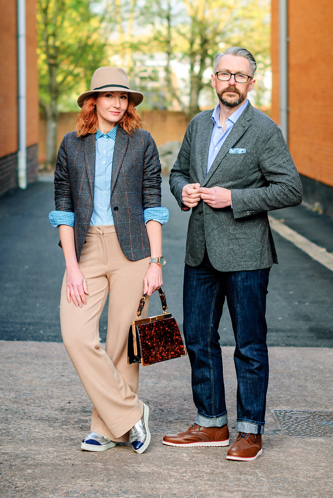 Smart British tailoring by Arthur Shirtley. Her: Check shirt tweed silk blazer camel wide leg trousers silver slip on sneakers camel fedora - Him: Dark wash jeans | Not Dressed As Lamb & Silver Londoner, over 40 style/menswear