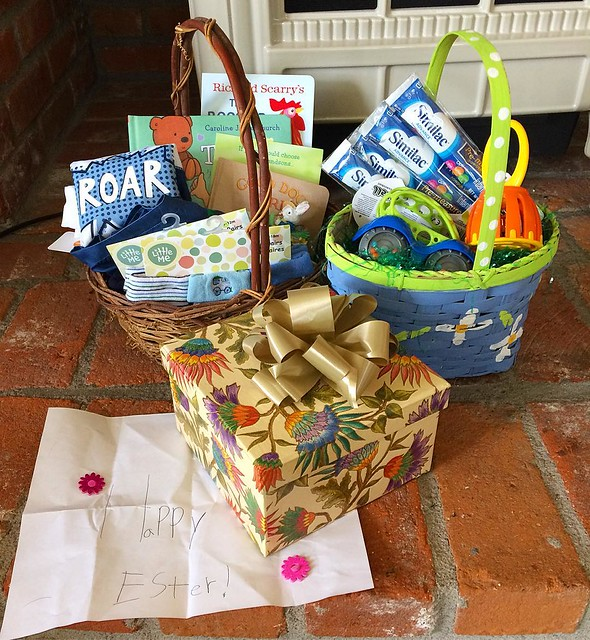 Happy Easter! Here's M.'s Easter presents--including a handmade card from Ronia, swim trunks from Grandma Fleeta and formula from us. 😂