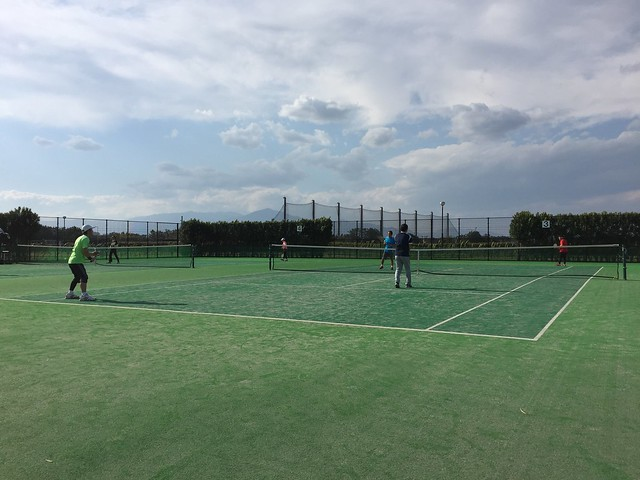 playing tennis in the strong wind