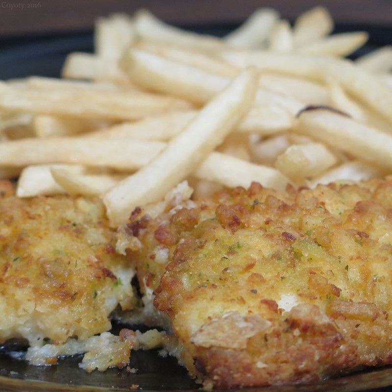 Potato-crusted cod with chives and cheese and fries