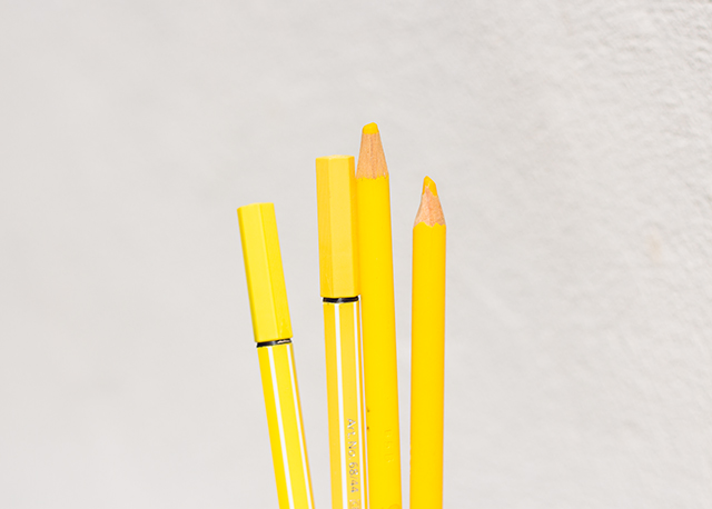 yellow pens and crayons