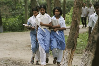 Three girls walk home from school | by World Bank Photo Collection