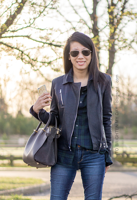 black leather jacket, black watch plaid button up shirt, gray tote, skinny jeans