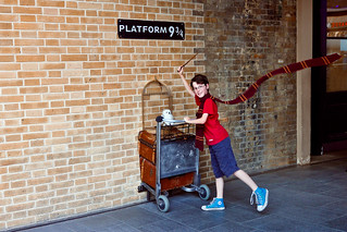 A young Harry Potter fan at the Platform 9 3/4 of King's Cross Station