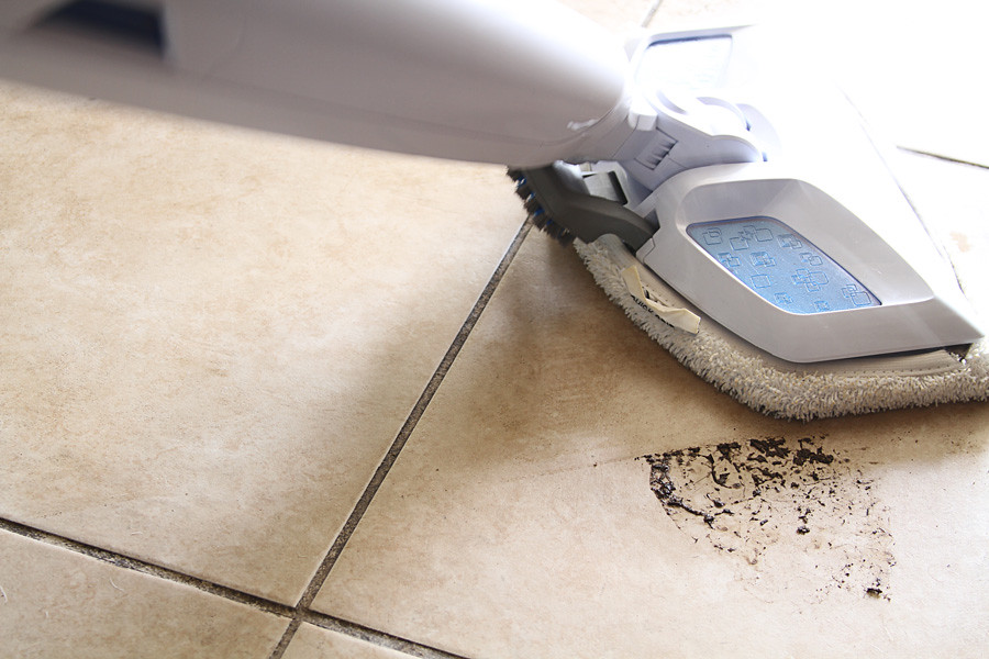 Steamer for cleaning tile floors