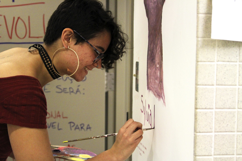 Students paint for transgender rights in art building bathroom