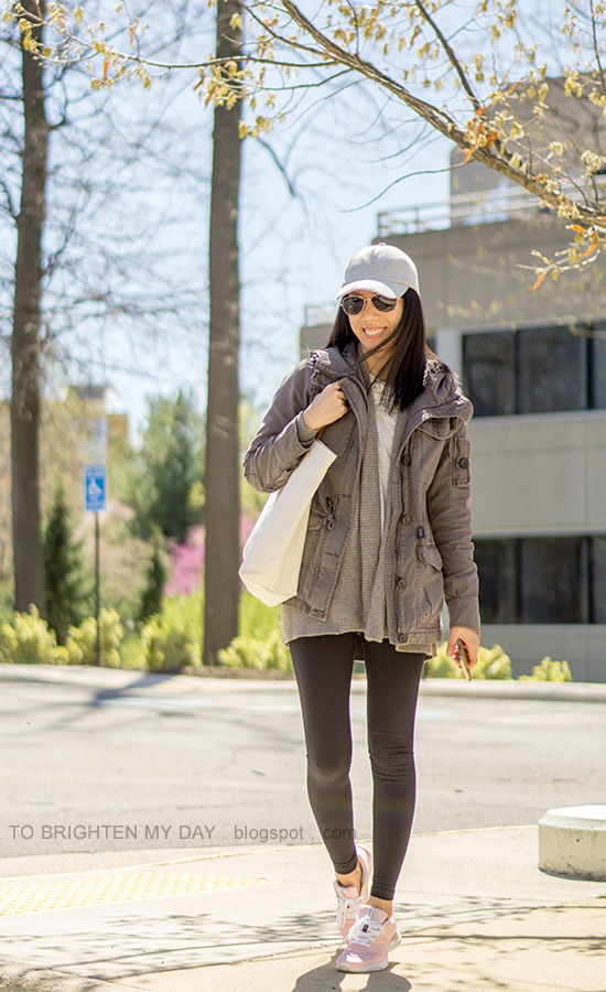 gray baseball cap, gray military jacket, taupe open cardigan, gray top with lace, canvas tote, black leggings, light pink sneakers