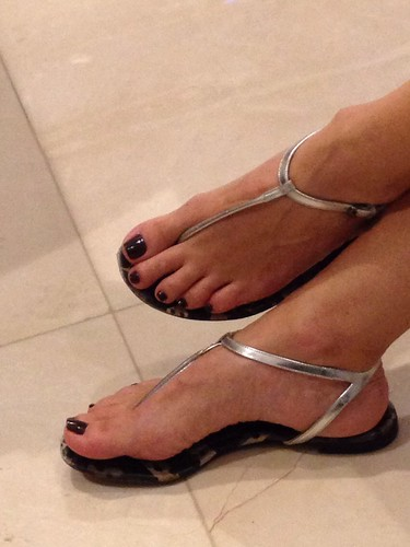Sexy feet in thong sandals