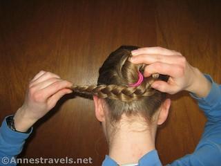 Keep winding the braid to make a Braided Bun - 12 Pretty & Practical Hiking Hairstyles