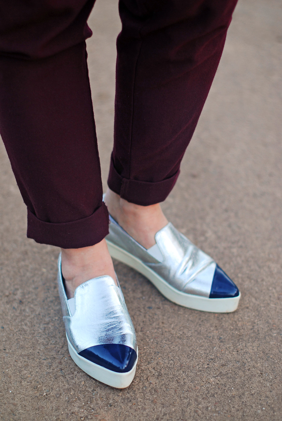 Easy-to-wear colours of plum and navy blue: Red and blue polka dot blouse plum peg leg trousers silver pointed toe slip trainers | Not Dressed As Lamb, over 40 style