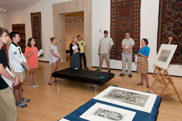 """Dr. Emily Burns welcomes students and visitors to """"A Little Art Talk"""" research presentation."""