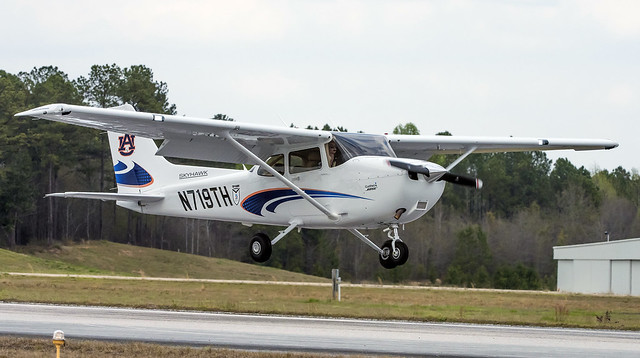 The new Auburn-logoed Cessna Skyhawk 172 aircraft lands at Auburn University Regional Airport.