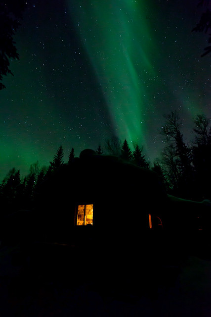 032717 - Green band of Aurora stretching over the cabin