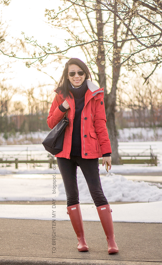 red performance anorak jacket, navy turtleneck sweater tunic, black skinny jeans, red rain boots