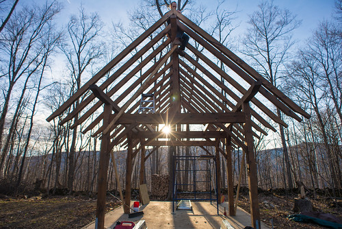 Tyler Affixing Rafter to Timber Frame Cottage Frame | by goingslowly
