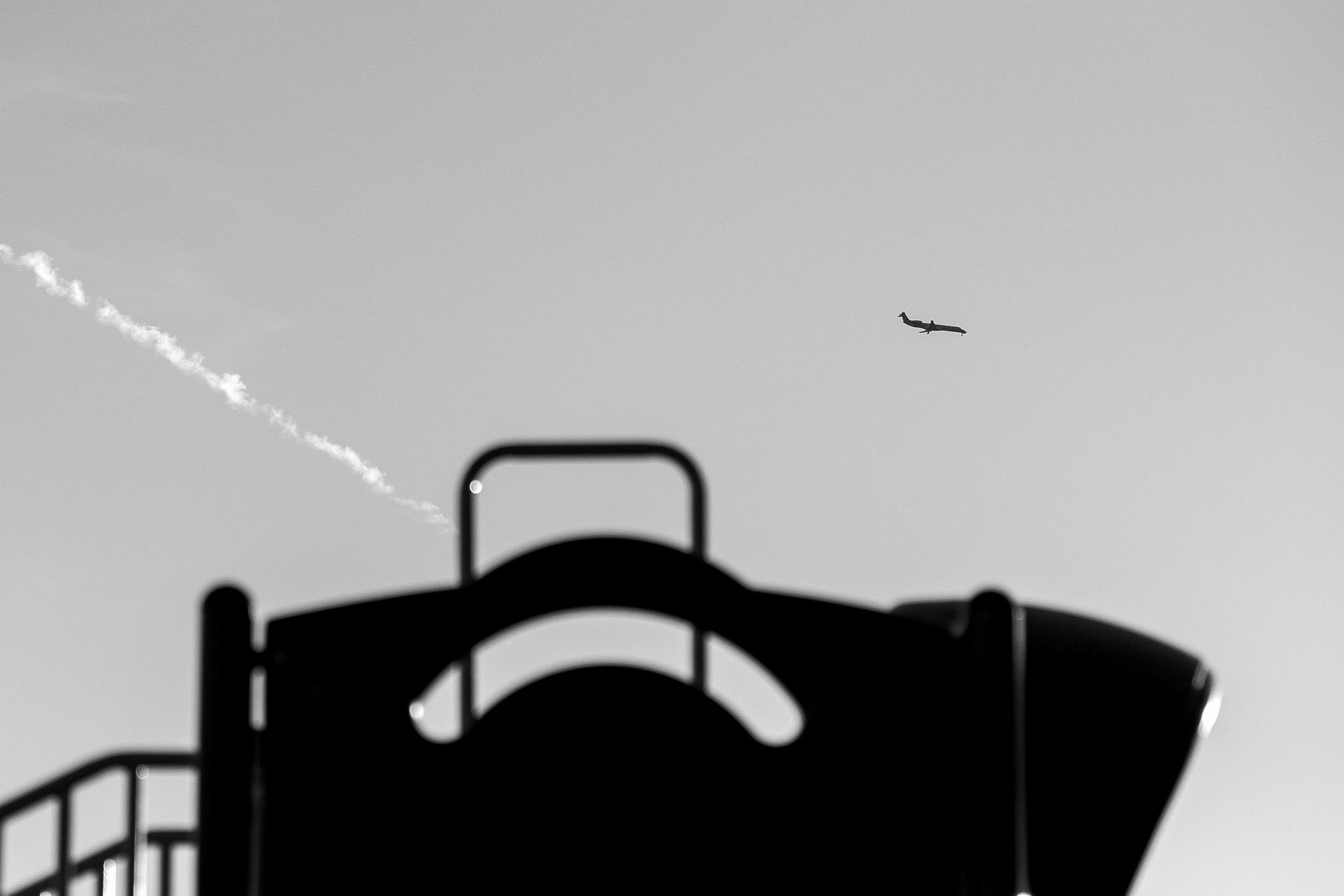 Plane over playground