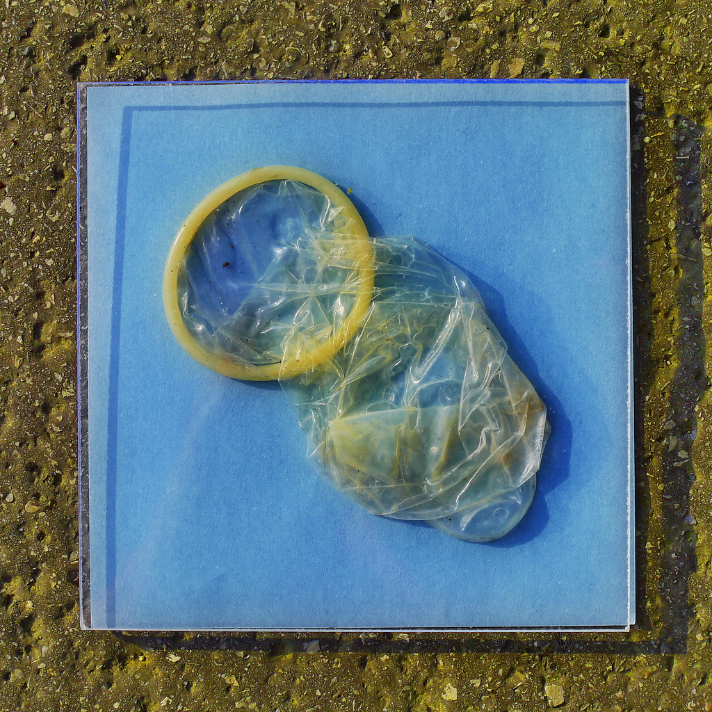 One Of The Found Condoms Behind Glass Making Of Photogr