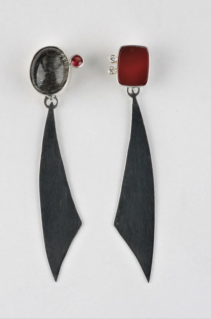 29e0b58a0 ... Asymmetrical black and red stud earrings