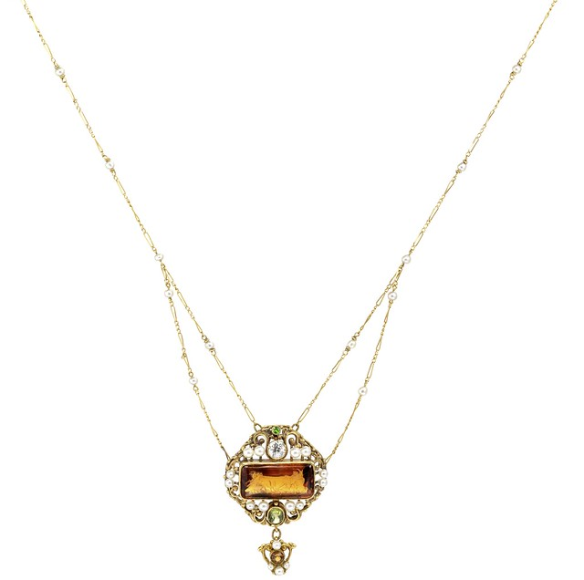 An Arts and Crafts citrine, diamond and gem-set pendant,  8