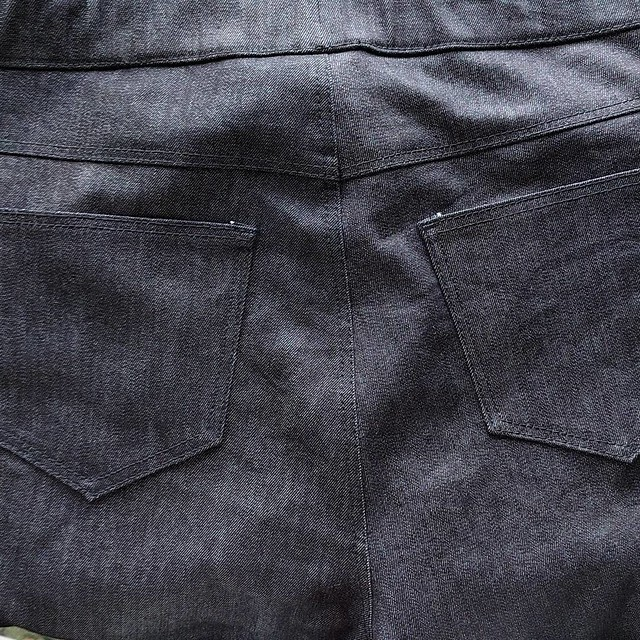 Close up of jeans back yoke and pockets.