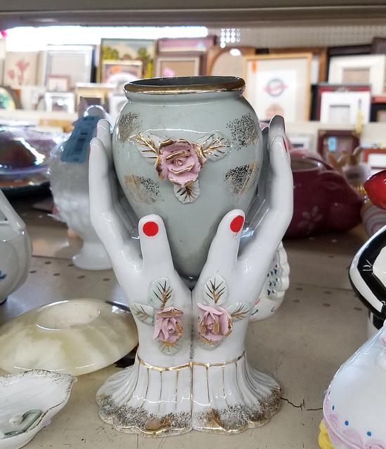 hands holding vase