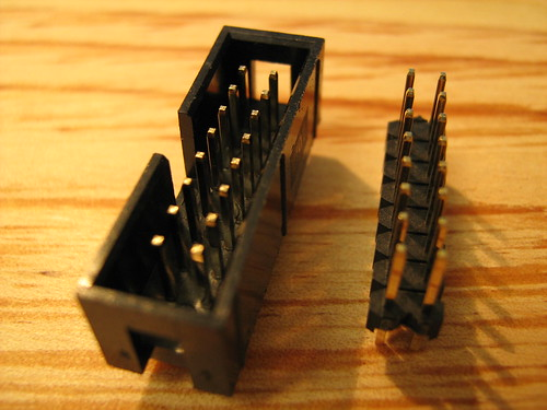 Keyed connector on the left, simple pin array on the right