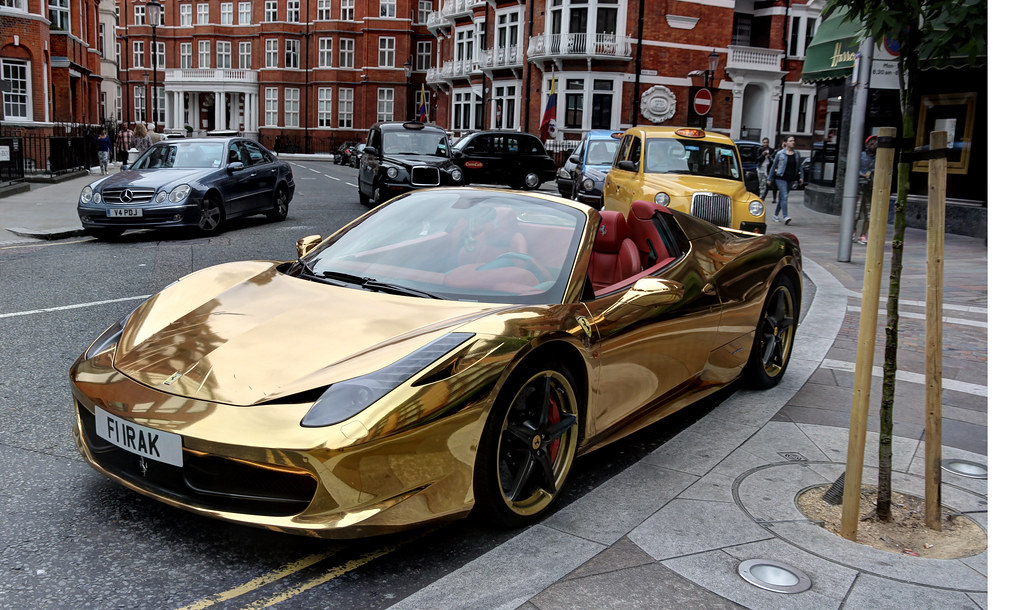 Ferrari 458 Spider Wrapped In Gold Belonging To