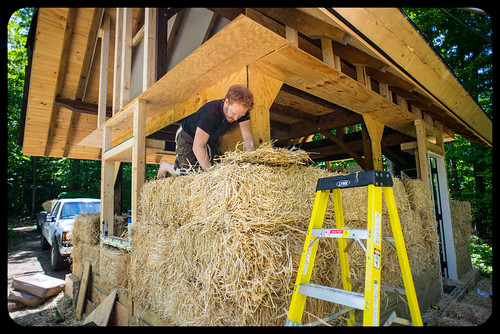 Tyler Stuffing Holes in Third Course of Straw Bales | by goingslowly