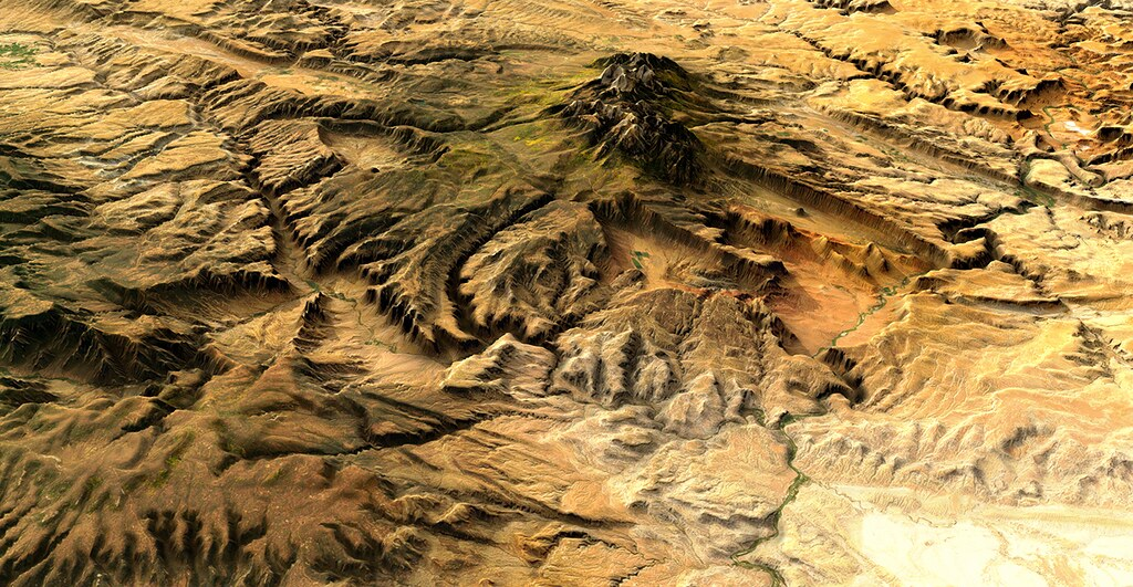 Close up on a sandy terrain with raised mountain range