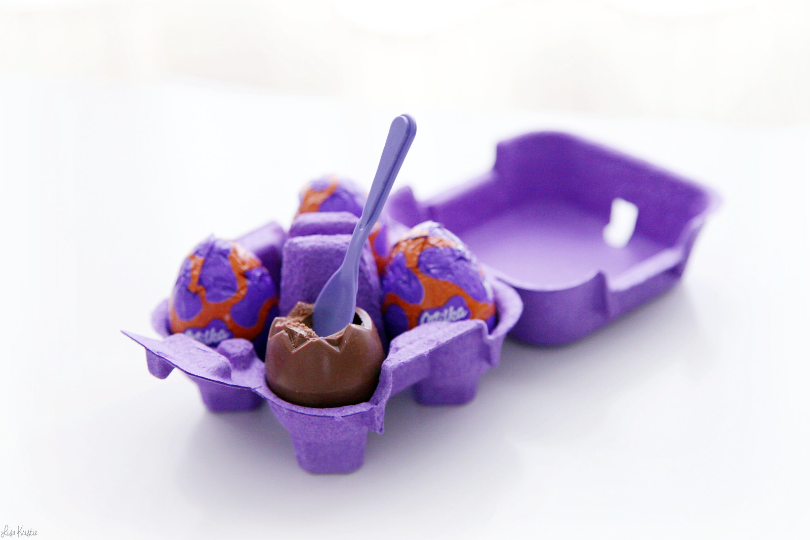 Milka chocolate easter eggs mousse with a spoon real egg carton purple eat inside filling