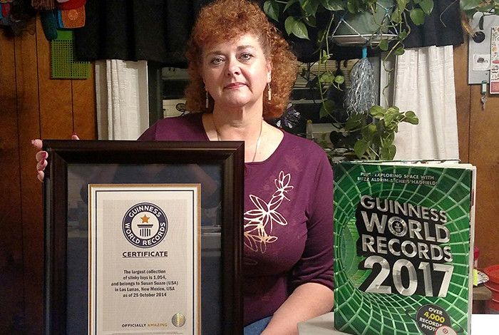 Susan Suazo-Martinez shows her certificate from Guinness World Records, which states that she has the largest collection of Slinky toys, which in 2014 amounted to 1,054. Since that time, her collection has grown to about 1,500.
