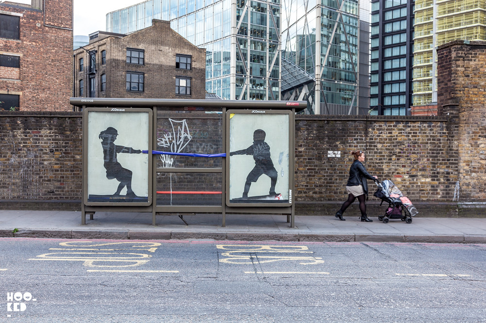 Adbusting with street artist Eyesaw in London, UK Photo© Hookedblog / Mark Rigney