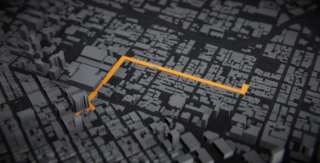 Dark grey cityscape with orange traffic pattern