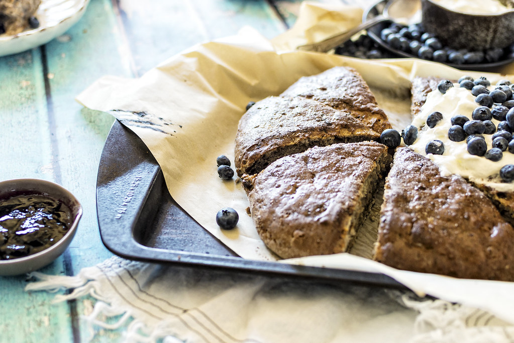 Looking to satisfy the sweet tooth, but stay a little on the healthy side? This recipe for Toasted Coconut Blueberry Banana Bread Scones is a high-protein treat that you'll love!