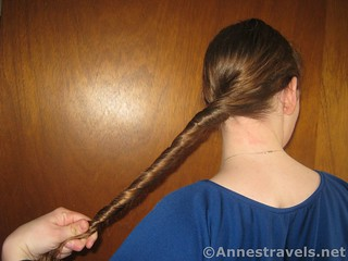 Twist almost to the end of the hair when making a Hair Elastic Twist Up - 12 Hiking Hairstyles that are Pretty & Practical