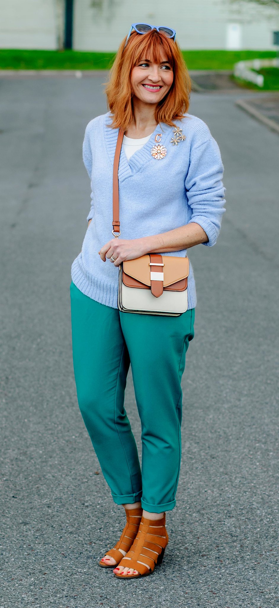 Spring look: Pale blue sweater \ emerald green peg trousers \ flower brooches \ tan strappy block heeled sandals \ two tone cross body bag | Not Dressed As Lamb, over 40 style
