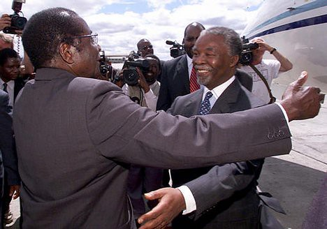 Zimbabwe president robert mugabe greeting former south afr flickr the two leaders are zimbabwe president robert mugabe greeting former south african president thabo mbeki the two leaders are m4hsunfo