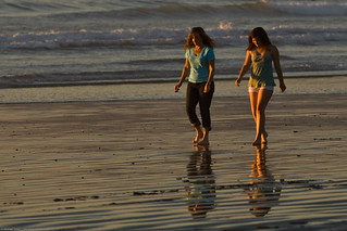 A Mother Daughter team (presumably) walk barefoot together on the beach | by mikebaird