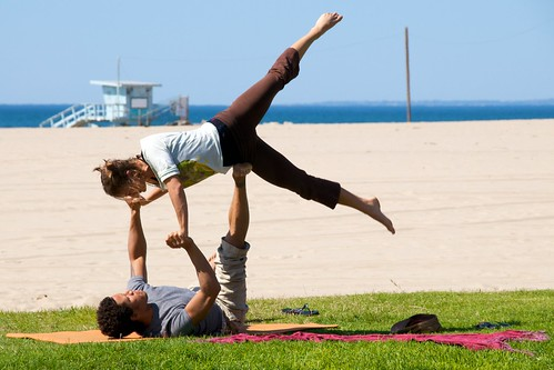 Couples Workout Doing Beach Yoga
