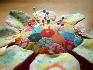 Close up of tiny patchwork on flower pincushion | by duniris