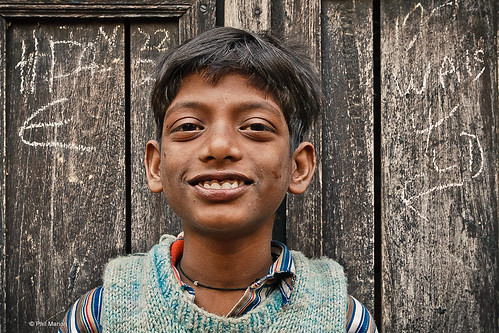 resident in the winding backstreets of Varanasi, India | by Phil Marion
