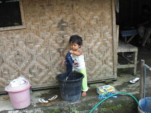 Little Girl Washing Clothes in Compound | by rtwjbcr