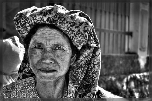 Old woman at market | by NeilsPhotography