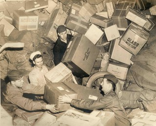U.S. Troops Surrounded by Holiday Mail During WWII | by Smithsonian Institution